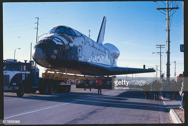 The space shuttle orbiter Columbia ties up traffic as it noses into a Lancaster intersection early 3/8 The shuttle is being towed to Edwards Air...