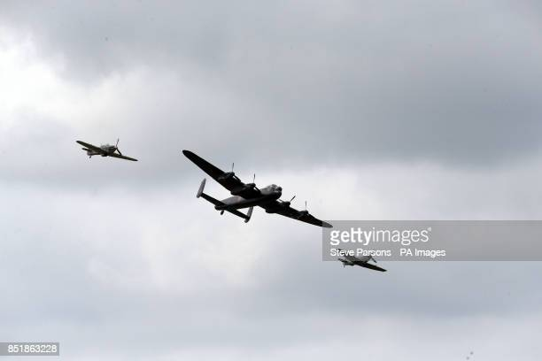 A Lancaster flanked by a Hurricane and a Spitfire take part in a 'Dambusters' 70th Anniversary display at RAF Fairford Wiltshire during the Royal...