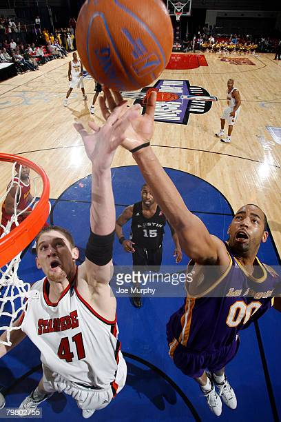 Lance Allred of the Red Team fights for a rebound against Jelani McCoy of the Blue Team during the DLeague AllStar Game presented by Spalding on...