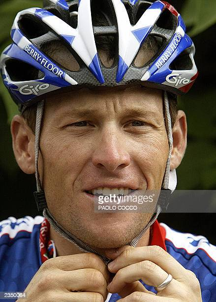 US Lance Armstrong adjusts his helmet during a rest day of the 90th Tour de France cycling race 16 July 2003 around Montpellier AFP PHOTO PAOLO COCCO