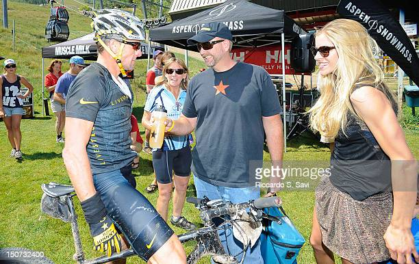 Lance Armstrong and Anna HansenArmstrong speak after the Power of Four Mountain Bike Race on Aspen Mountain on August 25 2012 in Aspen Colorado