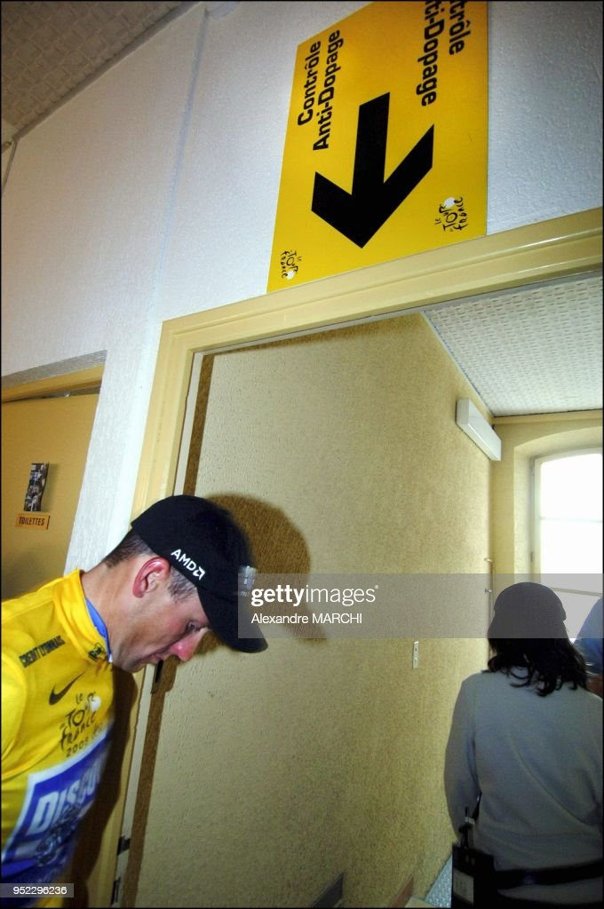 Lance Armstrong at a control anti-doping in the interior of a school ...