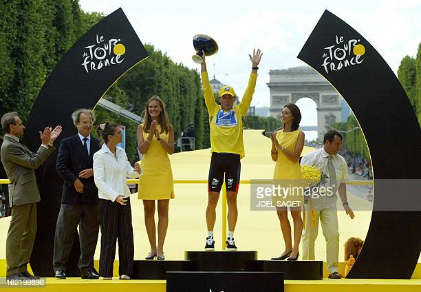 US Lance Armstrong celebrates on the podium at the end of the 20th and last stage of the 90th Tour de France cycling race between Ville d'Avray and...