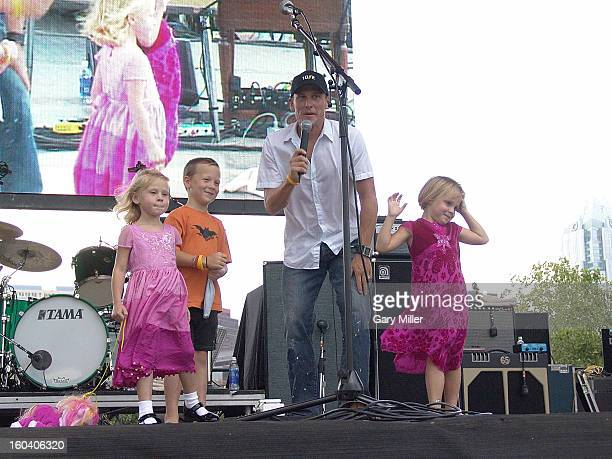 Lance Armstrong introduces his children Luke Armstrong and twins Isabelle Armstrong and Grace Armstrong at the Thank You Austin event after his...