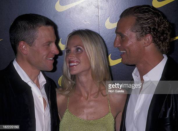 Lance Armstrong Kristin Richard and Matthew McConaughey attend the premiere of Lantana on November 6 2001 at the Pacific Design Theater in Hollywood...