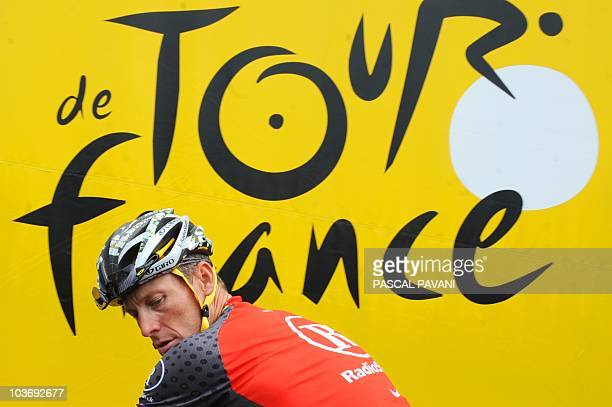 US Lance Armstrong leaves the signature ceremony on July 9 2010 prior to the start of the 2275 km and 6th stage of the 2010 Tour de France cycling...