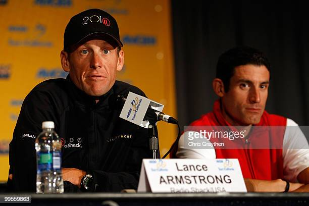 Lance Armstrong of Team Radio Shack speaks as George Hincapie of BMC Racing listens during a during a press conference prior to the 2010 Tour of...