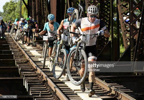 Lance Armstrong of the United States carries his bike across a railroad bridge during Day 3 of La Ruta de Los Conquistadores on November 3 2018 in...