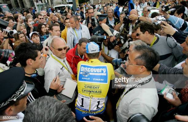 Lance Armstrong of the U.S. And Discovery Channel team prepares for the start of Stage 6 surrounded by news media during the 92nd Tour de France...