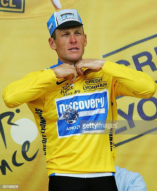 Lance Armstrong of the U.S. And Discovery Channel team receives the yellow jersey on the podium after his team won the Team Time Trial, Stage 4, of...