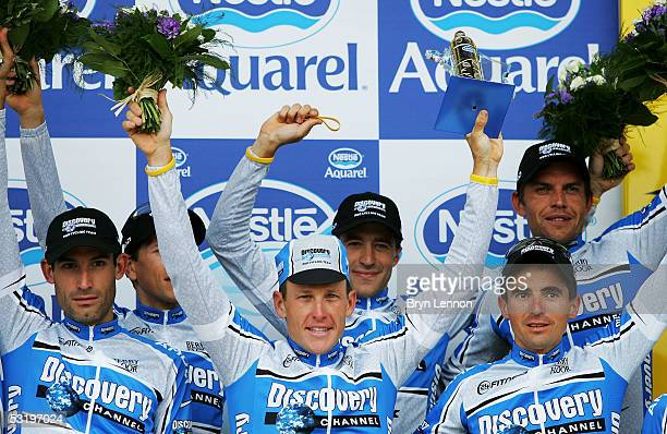 Lance Armstrong of the U.S. And the Discovery Channel Team celebrate on the podium after winning the Team Time Trial, Stage 4, of the 92nd Tour de...