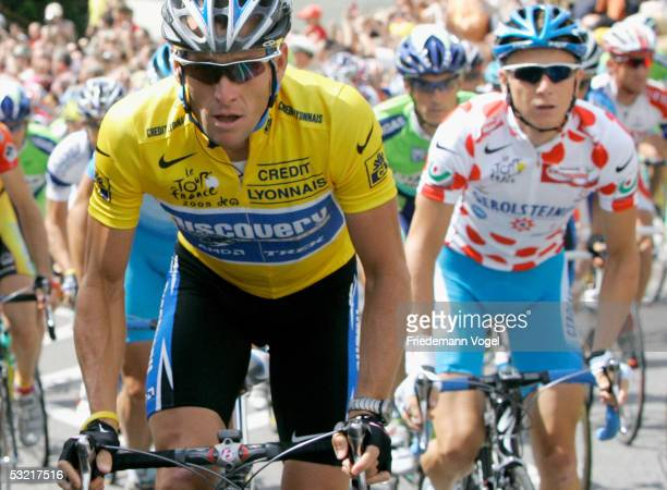 Lance Armstrong of the U.S. And the Discovery Channel team rides in the yellow jersey with Fabian Wegmann of Germany and Gerolsteiner in the polka...