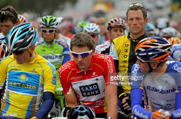 Lance Armstrong of the USA and riding for Astana observes the national anthem behind jersey holders Levi Leipheimer of the USA and riding for Astana...