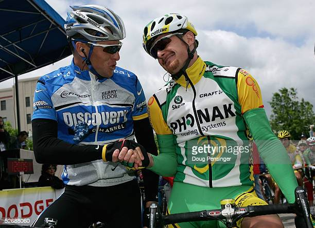 Lance Armstrong of the USA and riding for the Discovery Channel Pro Cycling Team greets Floyd Landis, in the leaders jersey, of the USA and riding...