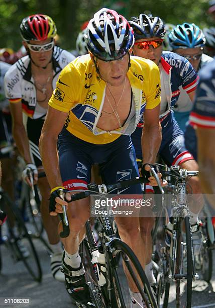 Lance Armstrong of the USA and riding for US Postal presented by Berry Floor climbs on the Col de la Croix Fry with the remaining members of the...