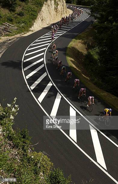 Lance Armstrong of the USA and Team US Postal Service leads the peloton down a hill during stage 18 of the 2002 Tour De France on July 26th, 2002...