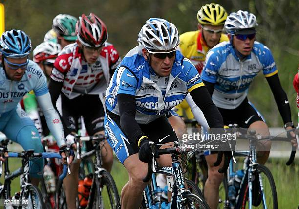 Lance Armstrong of the USA and teammate Tom Danielson of the USA and riding for the Discovery Channel Pro Cycling Team ride in the peloton during...