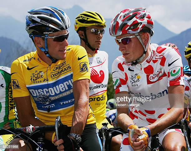 Lance Armstrong of the USA and The Discovery Channel Team chats to King of the Mountains leader Mickael Rasmussen of Denmark and Rabobank at the...