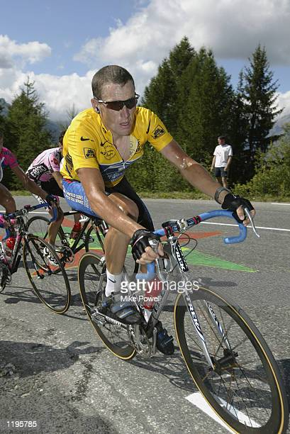 Lance Armstrong of the USA and US Postal Service Team climbs the final mountain to La Plagne for third place during stage 16 of the 2002 Tour De...