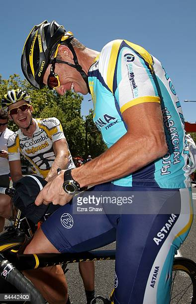 Lance Armstrong of the USA riding for Team Astana signs autographs for Michael Rogers of Australia riding for Team ColumbiaHighroad before the start...