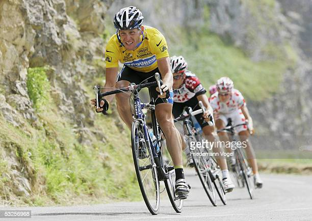 Lance Armstrong of the USA riding for the Discovery Channel cycling team, Ivan Basso of Italy from the CSC team and Mickael Rasmussen of Denmark from...