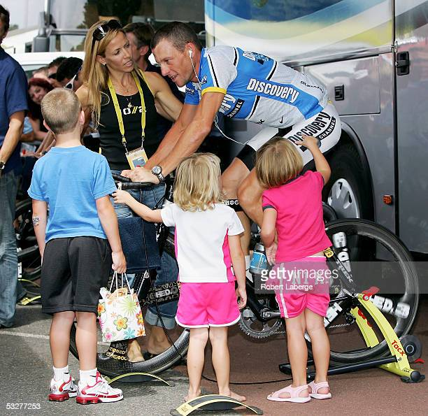 Lance Armstrong of the USA riding for the Discovery Channel cycling team with his children Luke Grace and Isabella and girlfriend Sheryl Crow before...