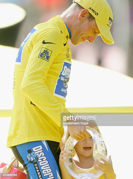 Lance Armstrong of the USA riding for the Discovery Channel cycling team with his daughter Isabella on the podium after stage 21 of the 92nd Tour de...