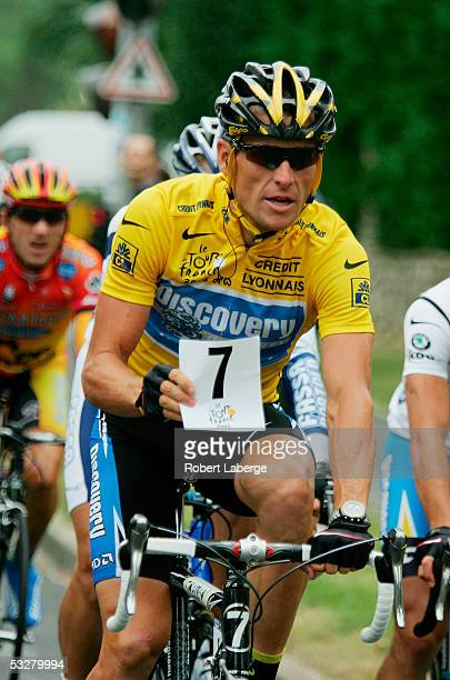 Lance Armstrong of the USA riding for the Discovery Channel team holds up the number 7 which represents him winning a seventh consecutive Tour de...