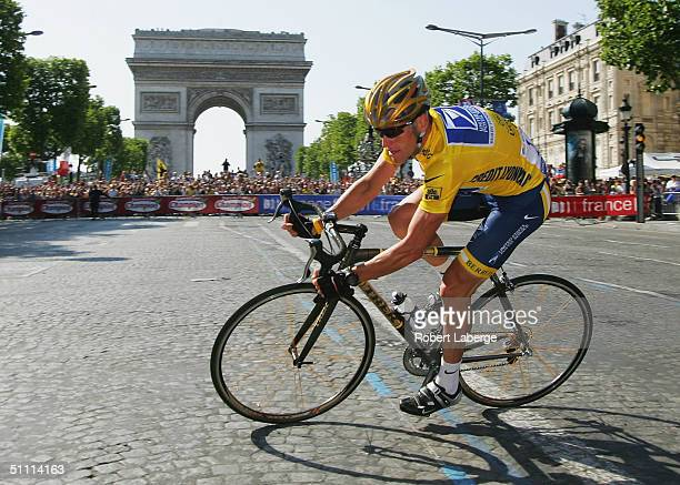 Lance Armstrong of the USA riding for the US Postal Service team presented by Berry Floor rides past the Arche de Triomphe on his way to winning a...