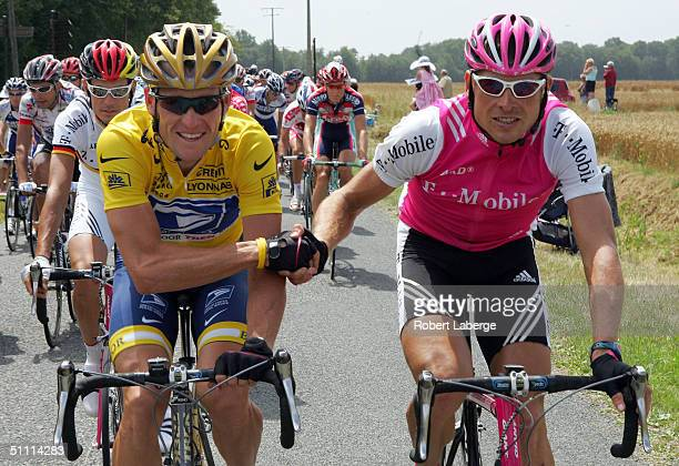 Lance Armstrong of the USA riding for the US Postal Service team presented by Berry Floor and Jan Ullrich of Germany riding for the TMobile team...
