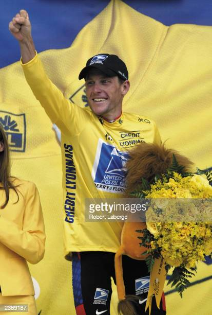 Lance Armstrong of the USA riding for the US Postal-Berry Floor team celebrates as he stands on the podium after winning stage fifteen between...