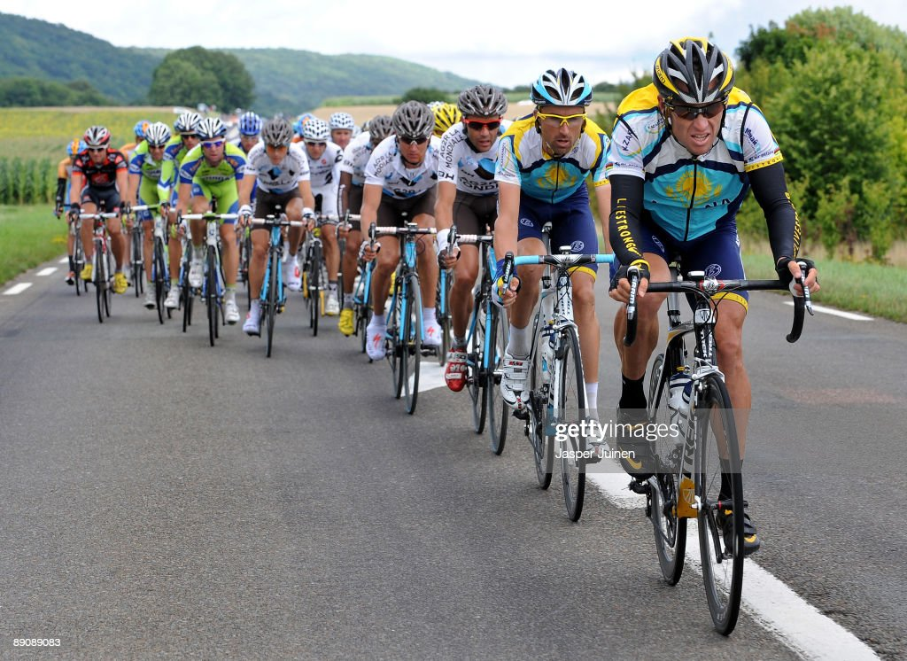 Lance Armstrong (R) of USA and team Astana rides with the peloton during stage 14 of the 2009 Tour de France from Colmar to Besancon on July 18, 2009 in Besancon, France.