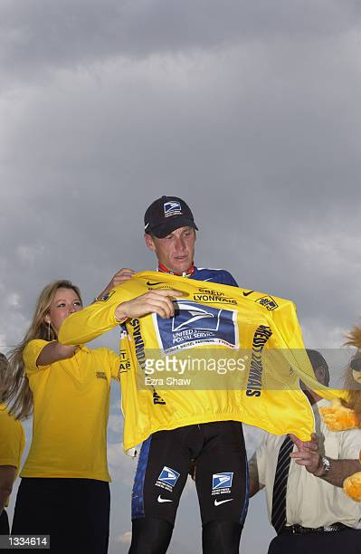 Lance Armstrong puts on the yellow jersey after stage 14 of the 2002 Tour De France on July 21th 2002 in Mont Ventoux France