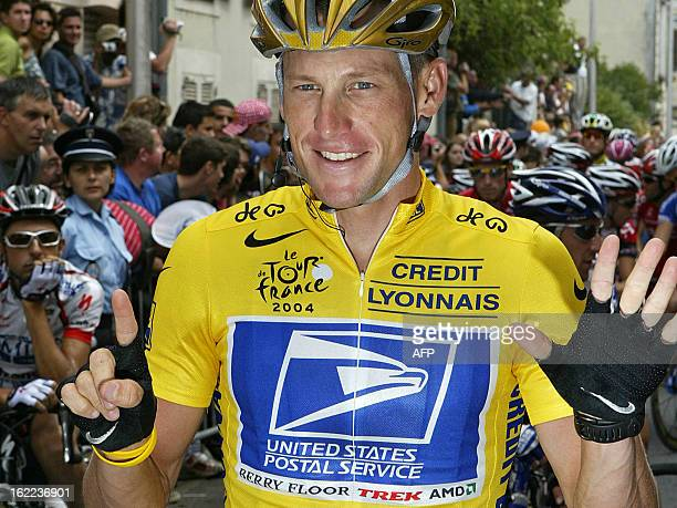 Lance Armstrong raises six fingers as a symbol of his possible sixth successive victory in the Tour at the start of the 20th and last stage of the...