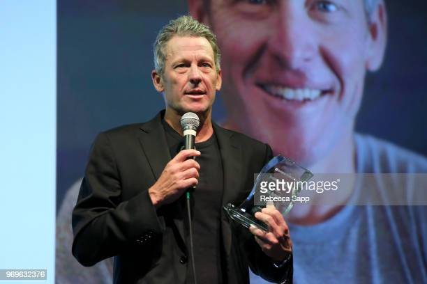 Lance Armstrong receives award at Babes for Boobs Live Auction Benefiting Susan G Koman LA at El Rey Theatre on June 7 2018 in Los Angeles California