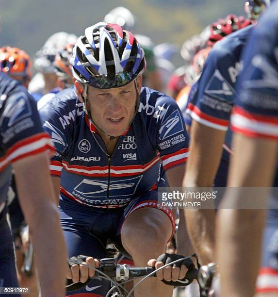 Lance Armstrong rides among his teammates in the pack during the second stage of the 56th Criterium du Dauphine Libere cycling race ran between...