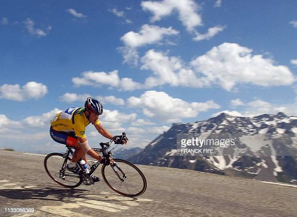 US Lance Armstrong rides down the Galibier mountain 14 June 2003 during the sixth stage of the Dauphine Libere race between ChalleslesEaux and...