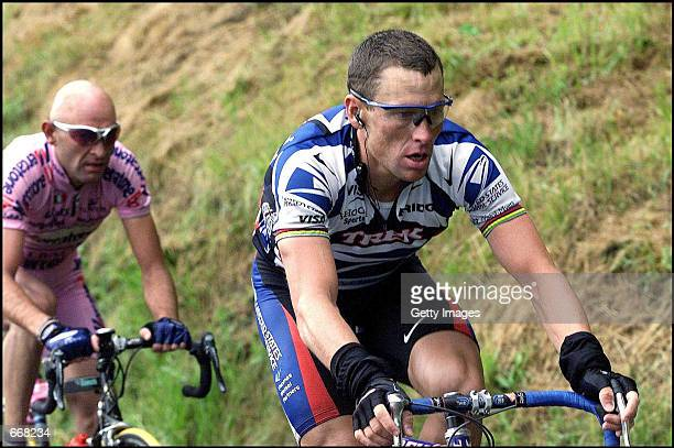 Lance Armstrong, right, and Marco Pantani ride in the 10th stage of the Tour de France July 10, 2000 en route to Lourdes-Hautacam, France. Armstrong...