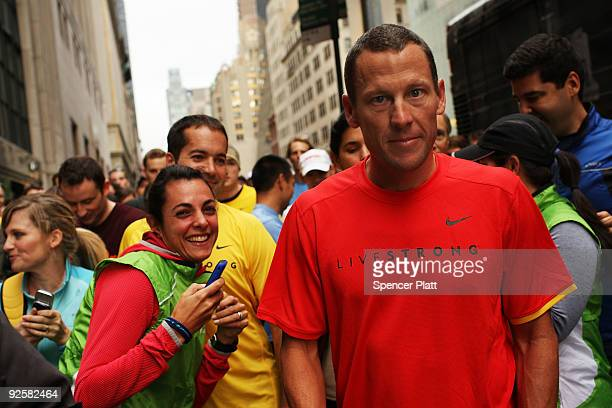 Lance Armstrong stands with runners and admirers in midtown Manhattan before a group run in Central Park on October 31 2009 in New York City...