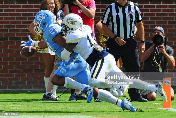 Lance Austin of the Georgia Tech Yellow Jackets breaks up a pass in the end zone intended for Devin Perry of the North Carolina Tar Heels on...