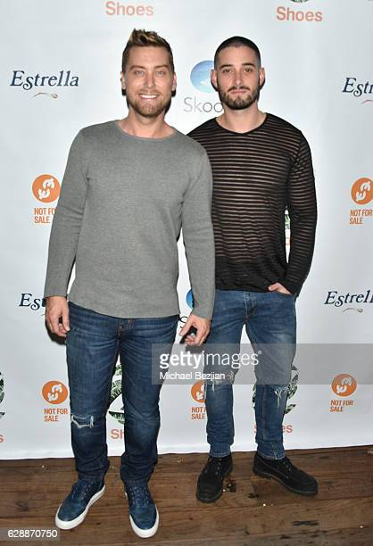Lance Bass and Michael Turchin arrive at Not For Sale x Z Shoes Benefit at Estrella Sunset on December 9, 2016 in West Hollywood, California.
