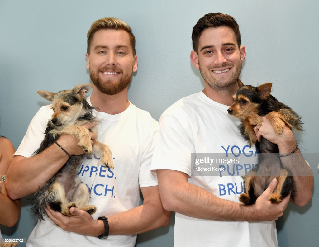 Lance Bass (L) and Michael Turchin with their dogs Chip and Dale at Natural Balance Pet Foods announce new formula with Lance Bass and Downward Dogs - Literally - at The DEN Meditation on August 23, 2017 in Los Angeles, California.