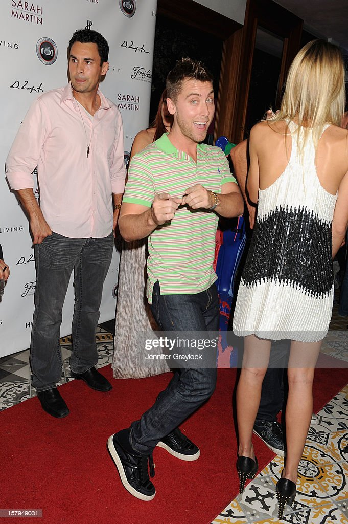 Lance Bass (C) attends the Domingo Zapata Installation at The W hosted by Haute Living and Hublot at SLS South Beach on December 7, 2012 in Miami, United States.