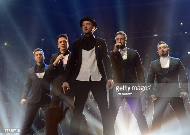Lance Bass, JC Chasez, Justin Timberlake, Joey Fatone and Chris Kirkpatrick of N Sync perform during the 2013 MTV Video Music Awards at the Barclays...
