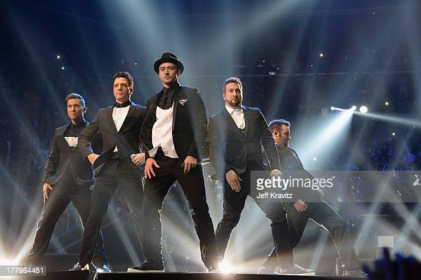 Lance Bass JC Chasez Justin Timberlake Joey Fatone and Chris Kirkpatrick of N Sync perform during the 2013 MTV Video Music Awards at the Barclays...
