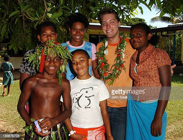 Lance Bass with village teachers and children during Kelly Slater Invitational Fiji Day 2 Mome Village Tour in Mome Village Tavarua Island Fiji