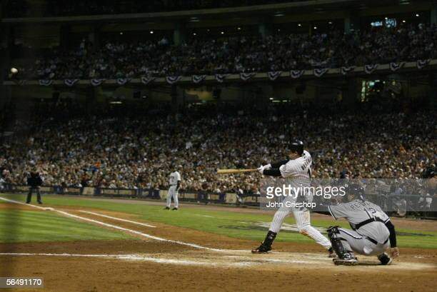 Lance Berkman of the Houston Astros bats as AJ Pierzynski of the Chicago White Sox catches and Astros first base coach Jose Cruz Sr looks on during...