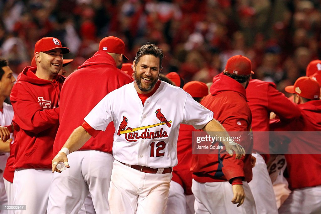 Lance Berkman #12 of the St. Louis Cardinals celebrates after David Freese #23 hits a walk off solo home run in the 11th inning to win Game Six of the MLB World Series against the Texas Rangers at Busch Stadium on October 27, 2011 in St Louis, Missouri. The Cardinals won 10-9.