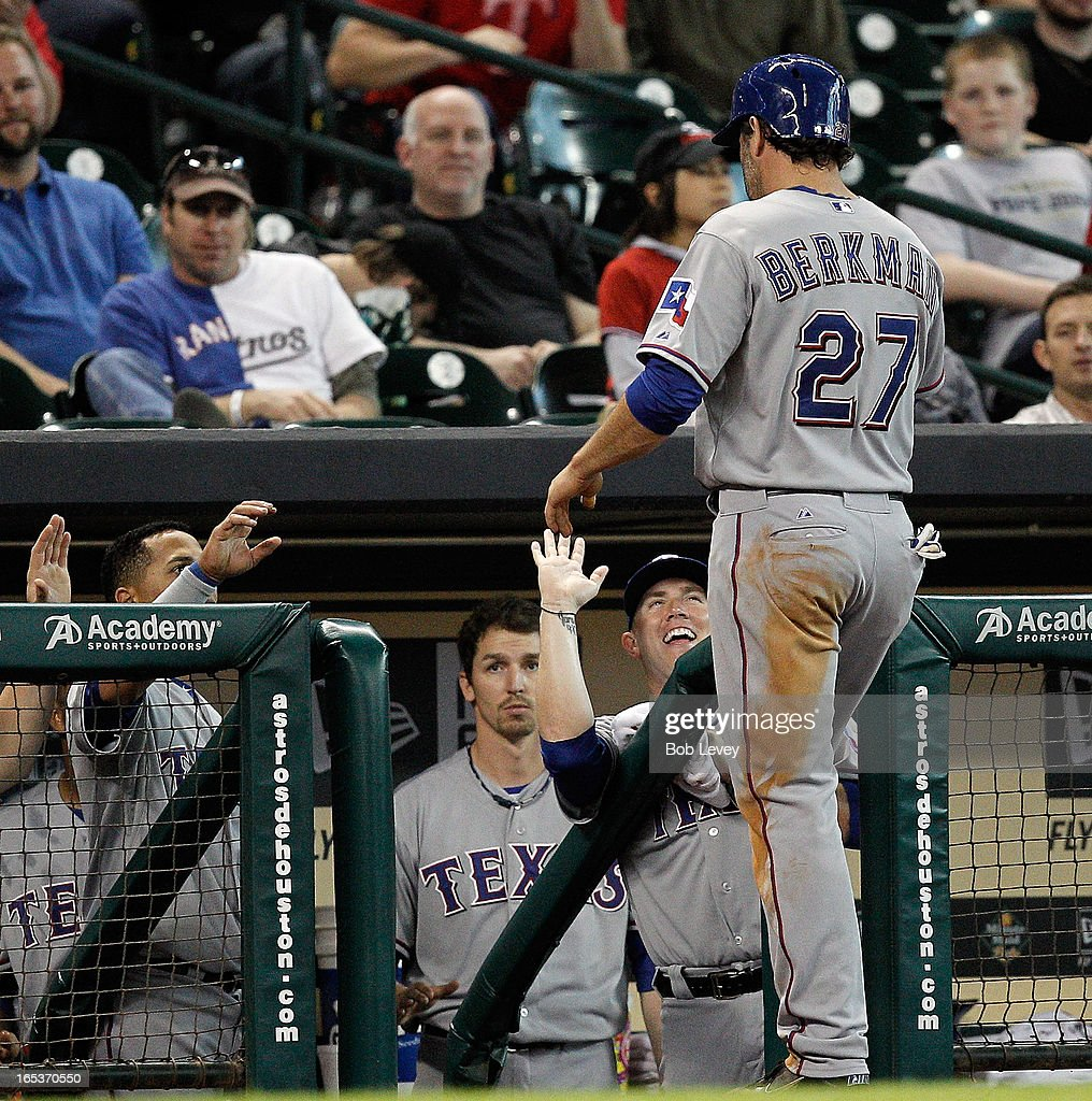 Lance Berkman #27 of the Texas Rangers is congratulated after hitting a double in the eighth inning against the Houston Astros at Minute Maid Park on April 3, 2013 in Houston, Texas.