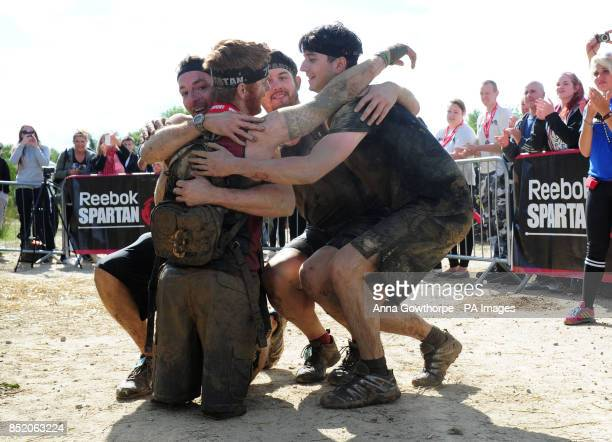 Lance Bombardier James Simpson a double amputee celebrates with his friends as he finishes the Spartan Race in Ripon North Yorkshire